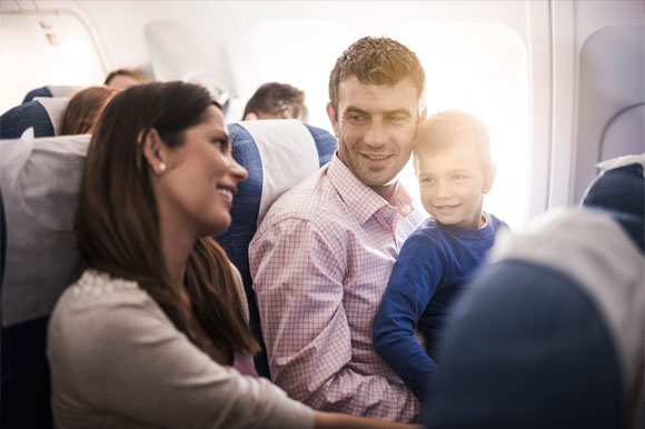 Smiling passengers on a flight
