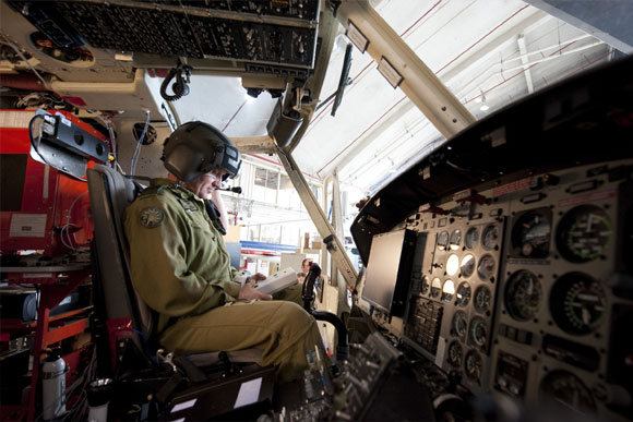 Helicopter pilot seated in cockpit
