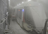 Railway tram under controlled conditions of intense snow